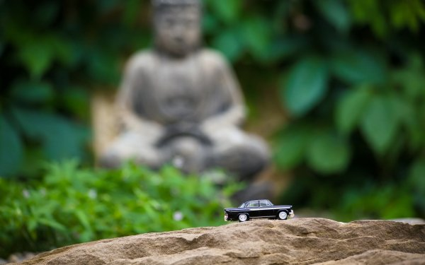 Photography Close Up Buddha Car Toy HD Wallpaper | Background Image