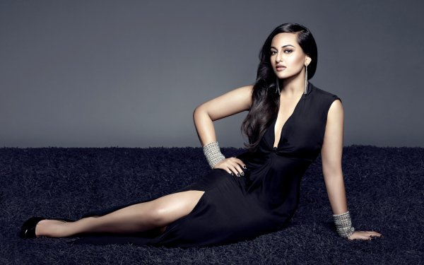 Celebrity Sonakshi Sinha Actresses India Sitting Bracelet Earrings High Heels Dress Black Dress Long Hair Brown Eyes Black Hair HD Wallpaper | Background Image